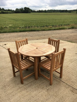 Teak garden furniture set: Churn 100cm fixed round table with 4 Grisdale straight back side chairs.