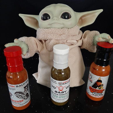 """An awesome trio of some of our best sellers. One bottle of """"Yo' 'Da Baby"""" Verde Sauce, One bottle of our 2nd hottest Wing Sauce, the Cluckwing Orange, and a bottle of our hottest Wing Sauce, the Curbstomp."""