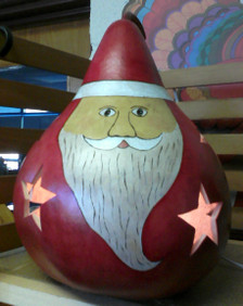 The Santa lights up and the glow shines through the stars. Each gourd is unique and no two Santas are identical.