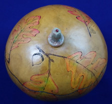 Beautiful wood-burned gourd box with autumn leaves.