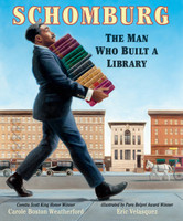Schomburg: The Man Who Built a Library by Carole Boston Weatherford, illustrated by Eric Velasquez.