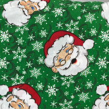 Christmas - PolyCotton - Santa Face Green Background