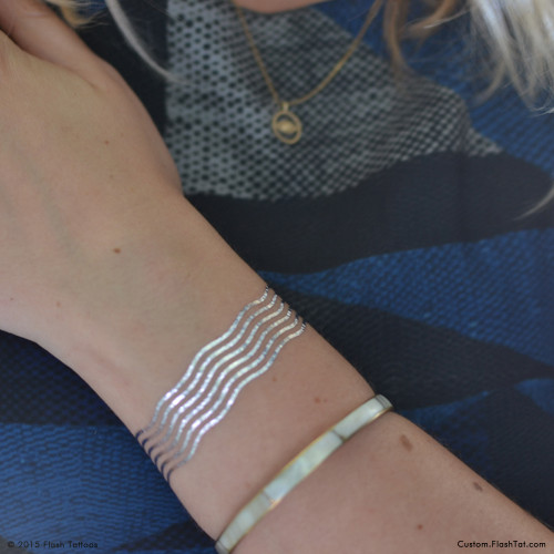Shimmer in this ocean-inspired metallic silver tattoo bracelet. @FlashTattoos