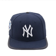 NEW YORK YANKEES 2000 WORLD SERIES LOGO LEATHER STRAP BACK - WOOL TOP VISOR