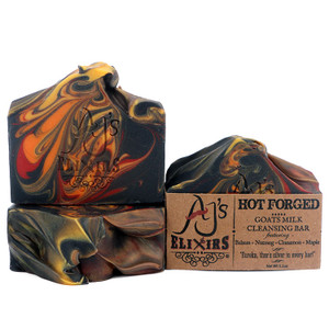 "AJ's Elixirs Goats Milk Bar Soap in Hot Forged scent; this creamy, moisturizing skin and hair loving bar has notes of Balsam, Nutmeg, Cinnamon and Maple. Looks like fire, because this bar is fire! ""Smells like man"" say users!"