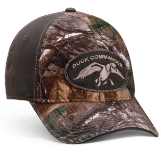 "2-tone, camo front and green back, complete with a green frayed patch with a cream Duck Commander logo on the front. Velcro back, this hat can be adjusted to fit most any size. Represent Duck Commander with one of our mottos ""Arise, Kill, Eat"" on the back.  100% Cotton Adjustable fit"