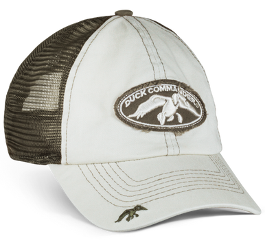"Putty front panels and bill, olive mesh back Made of 55% cotton and 45% polyester Twill, distressed patch on the center front displays the Duck Commander logo Duck Commander duck hit design on the back Hook-and-loop closure decorated with the words ""Arise, Kill, Eat"""