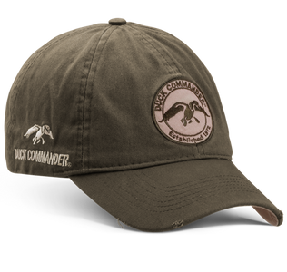 The Duck Commander Men's Circular Logo Cap is has the Duck Commander logo patch on the center front and also has the traditional Duck Commander saying—Arise, Kill, and Eat on back, with an additionl Duck Commander logo on the side.  It has velcro closure offers a great fit. Slighly distressed.