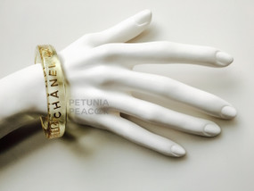 CHANEL LUCITE & GOLD LETTERED C H A N E L CC LOGO BANGLE BRACELET