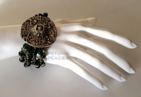 CHANEL VINTAGE EMERALD GREEN GRIPOIX & LION MEDALLION BRACELET