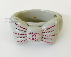 CHANEL BOW CUFF WITH LOGO IN GRAY & HOT PINK CRYSTAL BRACELET
