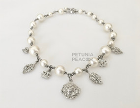 CHANEL SILVER CRYSTAL CHARM PEARL NECKLACE