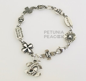 CHANEL ANTIQUED SILVER CROSS & CC LOGO BRACELET