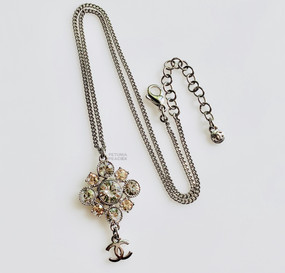 CHANEL CHAMPAGNE & CLEAR CRYSTAL LOGO NECKLACE