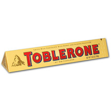 austiNuts carries Toblerone® Swiss Bittersweet Chocolate w/Honey & Almond Nougat to help you complete your perfect gift basket, care package, or if you are in the mood for great quality chocolate.   Snap off a chunk of Toblerone triangle piece and enjoy its terrific smooth chocolate taste!