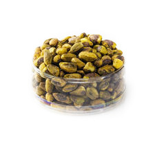 Dry roasted Pistachio Kernels in a clear container