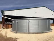 """40K Gallon Pioneer Water Storage Tank - Model XL30 shown with fascia & hold down concrete anchor kit. This installation included (2) 6"""" Overflows."""