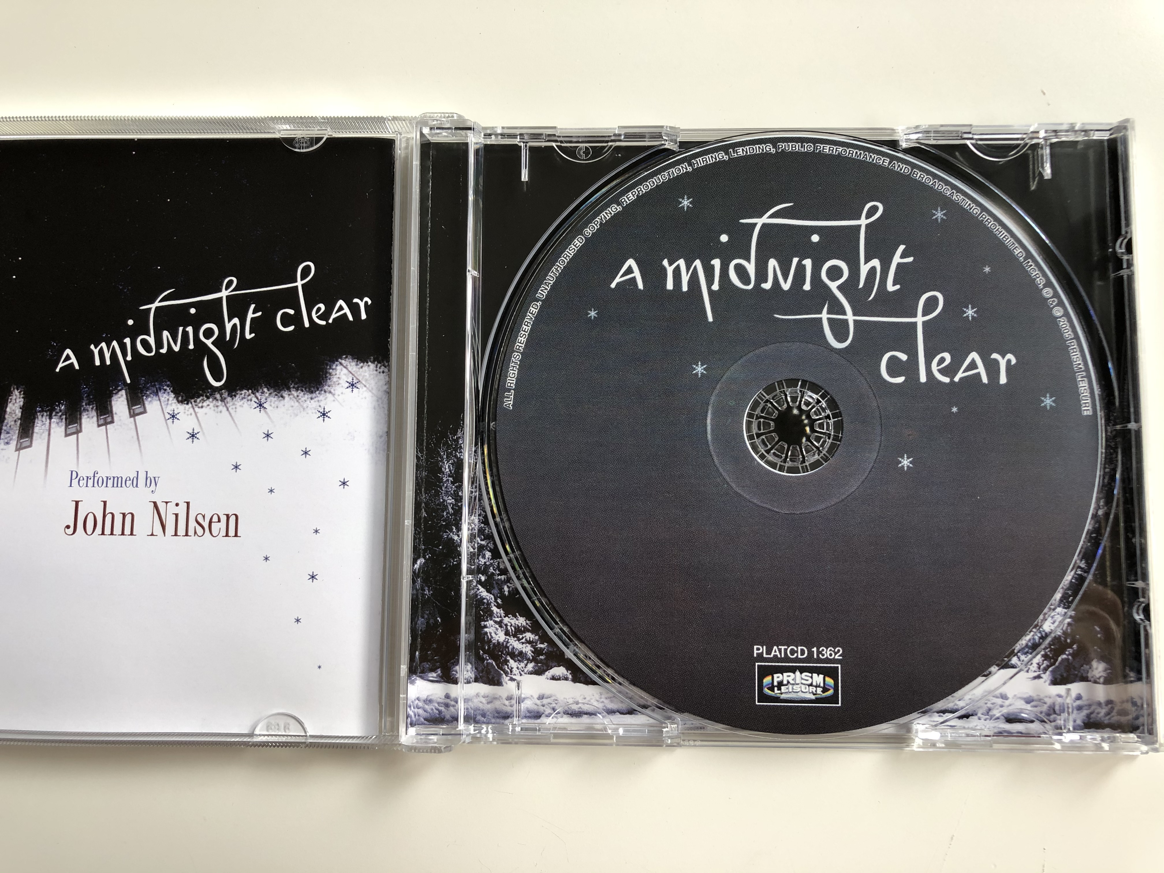 a-midnight-clear-enchanting-traditional-christmas-songs-on-piano-performed-by-john-nilsen-prism-leisure-audio-cd-2005-platcd-1362-3-.jpg