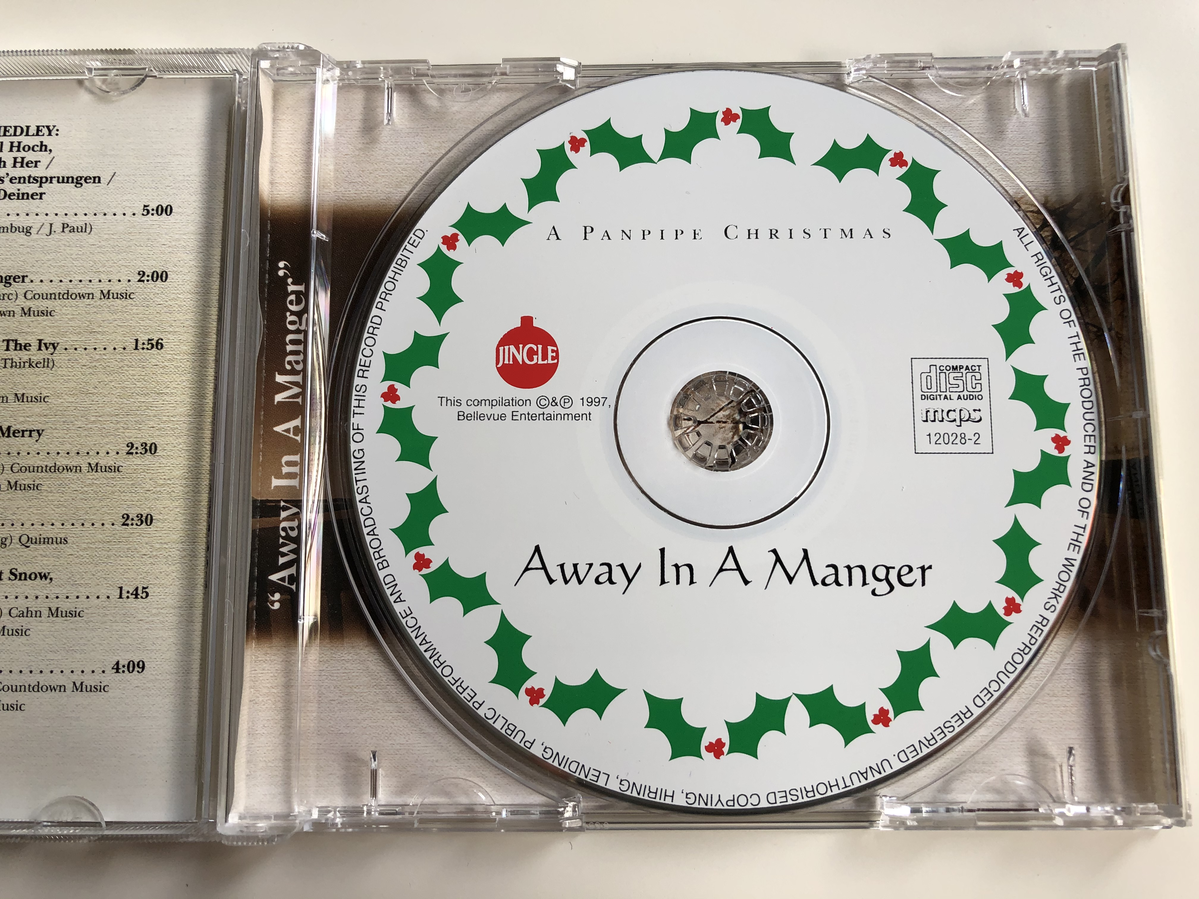 a-panpipe-christmas-away-in-a-manger-the-beautiful-sound-of-the-panpipes-includes-white-christmas-away-in-a-manger-oh-christmas-tree-o-come-all-ye-faithful-jingle-audio-cd-1997-12028-2-3-.jpg