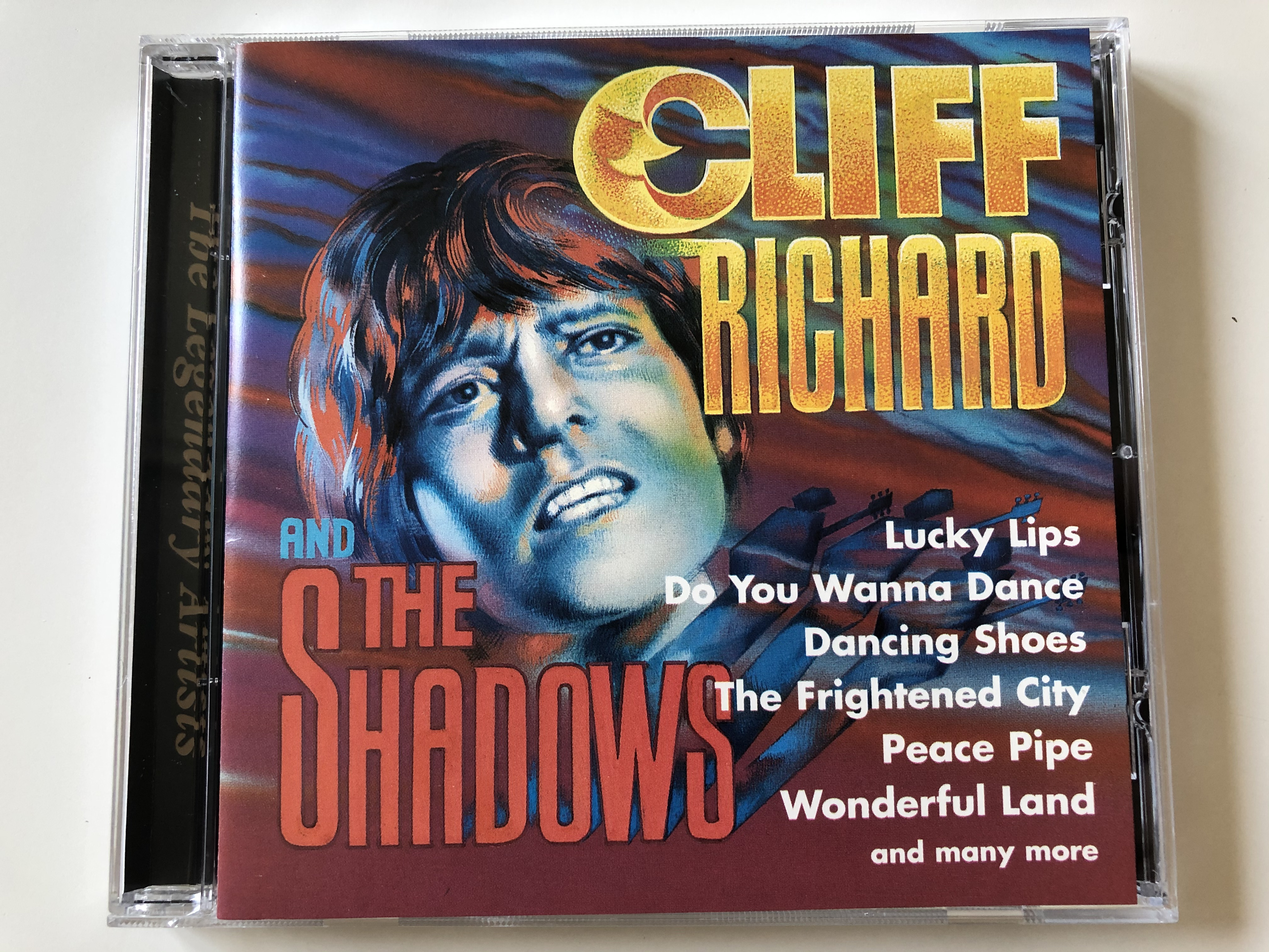 cliff-richard-and-the-shadows-lucky-lips-do-you-wanna-dance-dancing-shoes-the-frightened-city-peace-pipe-wonderful-land-and-many-more-mega-audio-cd-1997-mcda-87024-1-.jpg