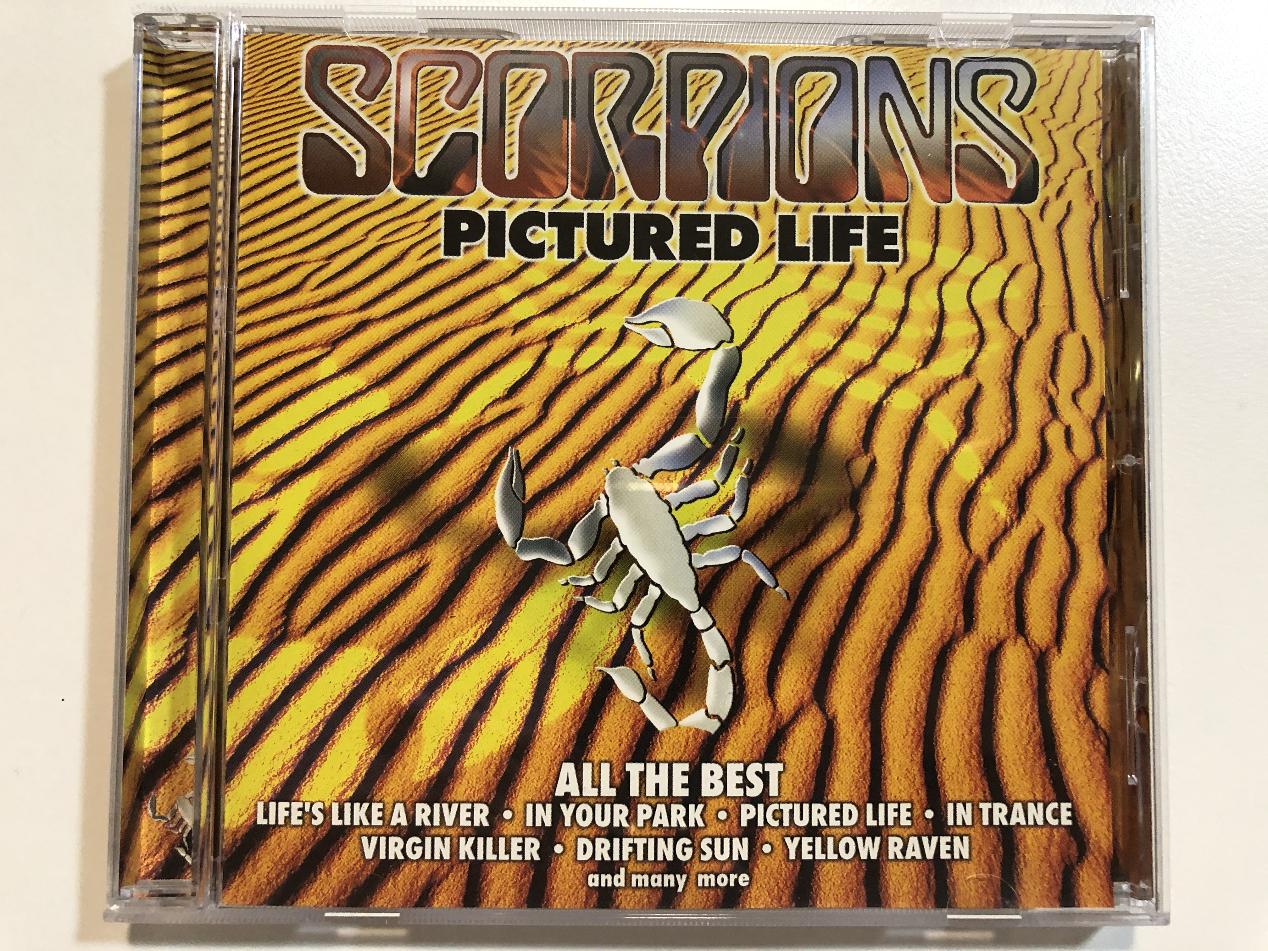 scorpions-pictured-life-all-the-best-life-s-like-a-river-in-your-park-pictured-life-in-trance-virgin-killer-drifting-sun-yellow-raven-and-many-more-bmg-audio-cd-2000-stereo-74321-1-.jpg