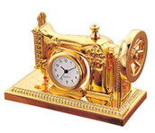 Gold Sewing machine clock - seamstress needle worker