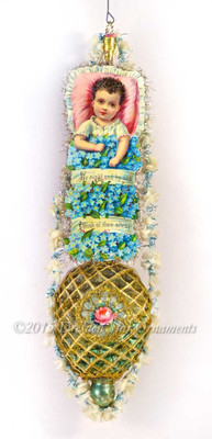 Amazing Victorian Baby With Forget-Me-Nots On Elaborately Decorated Antique Molded Blue Ornament