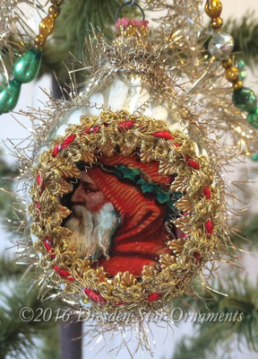 Santa with Orange-Red Hood on Oval Silver Indent Ornament