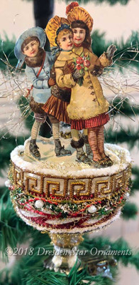 Reserved for Susan – Girls Ice-Skating on Glass Spindle Ornament Adorned with Miniature Garland