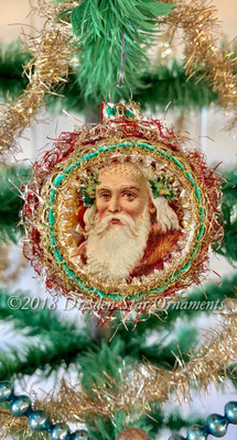 Santa with Frosty Beard in Red Indent Ornament accented green and gold trim.