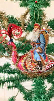 Riding Santa in Blue Coat Astride a Large Red Glass Bird-Swan
