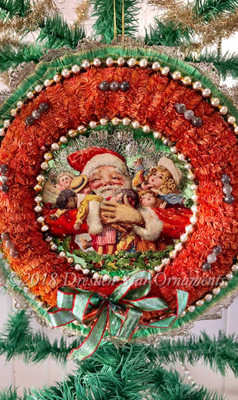 Santa Hugging Doll Toys Inside Rust-Red Chenille Wreath Accented with Glass Beads