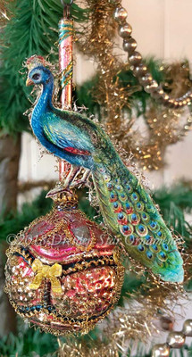 Delicate Peacock Posed on Antique Molded Pink Ornament