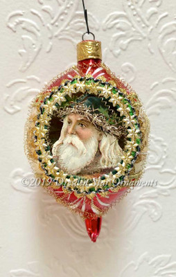 Santa with Blue Cap on Stunning Oval Red-and-White Mid-Century Indent Ornament