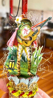Serenading Frog with Cape and Guitar on Red Glass Bell Ornament