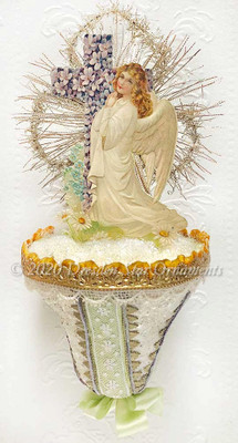 Easter Angel with Cross of Violets on Glittered Paper Bell Trimmed with Green Ribbon and Lace