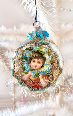 Victorian Child in Antique Bumpy Glass Indent decorated with Tiny Blue Fabric Flowers and Delicate Glass Beadwork