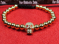 Gold Bead Red Eye Skull Bracelet