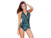 This is the perfect swimsuit.  Shown as a One Piece.  Can be worn as a High Waist, Bikini, or anywhere in between.   Easily changes in seconds by simply folding the bottom piece either up or down. Paisley outside fabric and Black inside layer. As a one piece it will look Paisley, but when you fold it down to a bikini the Black color will show. Four-way stretch fabric provides you with extra tummy control and an easy and comfortable fit. 82% poly 18% spandex Made in the USA Chic and Sexy Halter Top is always in style. Features include adjustable soft neck and back ties, and removable bra padding.   Multikini Bottoms are adjustable, convertible, and versatile. This is the bottom that does it ALL. Fits All Body Types