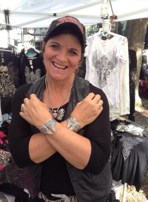 This biker wears two to guard her safely on her rides! #AngelWingBracelets