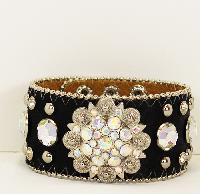 Bracelet, rhinestone bling on a leather bracelet, adjustable length and 3 snap closure.  Check out all the sass at Go Brazen.com. Weather riding your bike or your horse, this bracelet will top off your outfit. Swing on by the Go Brazen store in Red Wing , Minnesota