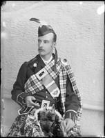 W J Macpherson (1866-1923) in tartan, ca.1888