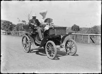 Macpherson Family in automobile.