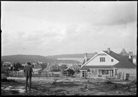 Houses and view over Middle Harbour with photographer (Macpherson) standing in foreground.