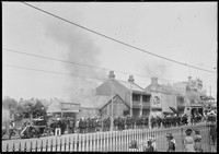 Fire brigade in action and crowds on the street outside Eugene Viau & Co, 40 City Road, Darlington, 2 February 1905.
