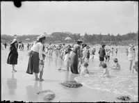 Beach scene with Coogee Pavilion in distance.