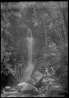 Two women at base of Waterfall.
