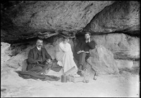 E H Macpherson with (Lucy) and (Septimus) seated under rock ledge.