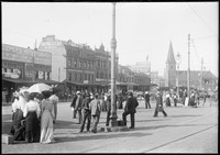 Pedestrians near Murcott's Railway Hotel, looking north along George Street to Christ Church St Lawrence, ca. 1900.