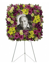 "Mosaic Memories Square Photo Tribute Funeral Spray from Sympathy Flower Shop. The elegant standing spray includes purple alstroemeria, green gladioli, green carnations, purple cushions, lavender buttons, green buttons and purple buttons, accented with assorted greenery. Approximately 23"" W x 23"" H  SKU SYM209"